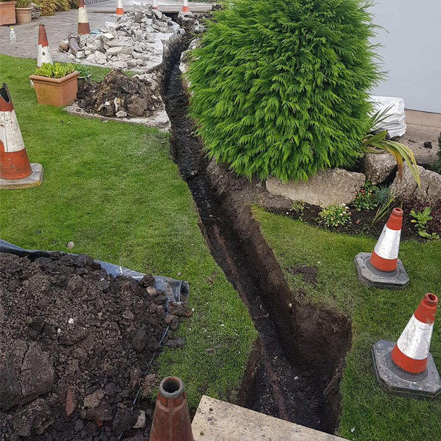 Installation of drainage pipe through garden.